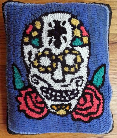 traditional Mexican design in a hooked rug