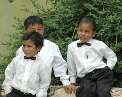 Rich Roots. Mexican children school graduation